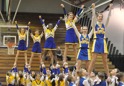 "Lyons Township cheerleaders fill the floor at halftime of the varsity girls basketball game. LT holds a ""Pack the Place"" event with back to back girls and boys basketball games, with fundraising by LT school organizations on Saturday, Jan. 26, 2013. Bill Ackerman — backerman@shawmedia.com"