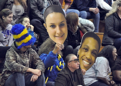 "Lyons Township fans wear the gold and blue and hold cutouts of  players' faces at  LT's ""Pack the Place"" event during the varsity girls basketball game, with fundraising by LT school organizations on Saturday, Jan. 26, 2013. Bill Ackerman — backerman@shawmedia.com"