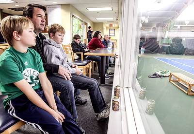 Sarah Nader- snader@shawmedia.com Adam Bautsch (left), 9, of West Dundee and his dad, Michael, and brother, David, 11, watch a singles match during the 5th annual Walt Herrick 5th Annual Walt Herrick, Sr. Memorial Men's Prize Money Tennis Open at the Racket Club in Algonquin Saturday, January 3, 2014. The open runs through Sunday and raises funds towards tennis lessons for deserving boys and girls in the local community.  Every year, the Foundation awards Racket Club tennis instructional scholarships for applicants who demonstrate dedication on and off the court to tennis, academics, and the improvement of their surroundings.