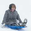 Maria C. of Batavia enjoys the afternoon snowfall sledding at The Fabyan Forest Preserve in Geneva, IL on Wednesday, January 01, 2014 (Sean King for Shaw Media)