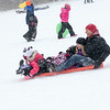 (front to back) Batavia Residents Noel, Landon, Madison and Mike Moore of Windfield enjoy the afternoon sledding at The Fabyan Forest Preserve in Geneva, IL on Wednesday, January 01, 2014 (Sean King for Shaw Media)