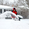 Jim Vial digs out of his St. Charles driveway Thursday morning after the area's New Year's Day snowfall.