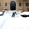 Jeffrey Walter, 12, shovels the steps of St. Gall Catholic Church in Elburn Thursday afternoon. Over 7 inches of snow was reported in Elburn.