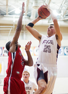Sarah Nader- snader@shawmedia.com Prairie Ridge's Ryan Gilbert shoots during the first quarter of Saturday's home game against Grant January 3, 2014. Prairie Ridge defeated Grant, 64-42.