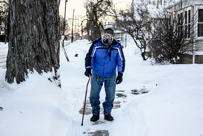 Sarah Nader- snader@shawmedia.com Despite the freezing cold weather James Bennett of Woodstock takes his daily walk around his neighborhood Monday, January 6, 2014. Sub-zero temperatures are expected through Tuesday morning with wind chills ranging from 30-50 below zero.