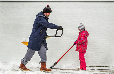 "Kyle Grillot - kgrillot@shawmedia.com   Ryan Coffey shovels his driveway with his daughter Kendall, 7, Sunday in Fox River Grove. ""Better off to take care of this before tomorrow,"" said Coffey referring to the extremely cold weather expected in the area. Wind chills are expected to be 30 below zero, with wind chills of 40 to 50 below zero expected into Monday afternoon. The weather service is forecasting a prolonged period of dangerously cold wind chills from Sunday night through Tuesday morning."