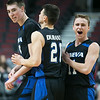 Geneva's Nate Navigato (left) celebrates with team mates after sinking a three point shoot against Kaneland late in the fourth quarter of play at The Preps with Pros Basketball Game at the United Center in Chicago, IL on Saturday, January 04, 2014 (Sean King for Shaw Media)