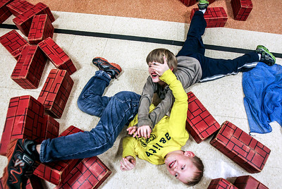 Sarah Nader- snader@shawmedia.com Second graders Nicky Williams (left), 8, and John Leaks, 8, both of Oakwood Hills, play with blocks while at an after-school program at Prairie Grove Elementary School in Crystal Lake Wednesday, January 8, 2014.