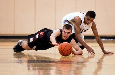 Sarah Nader- snader@shawmedia.com McHenry's Cody Freund (left) and Jacobs' Kenton Mack dive for a lose ball during the second quarter of Wednesday's game in Algonquin January 8, 2014. Jacobs defeated McHenry, 50-53.