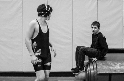 Sarah Nader- snader@shawmedia.com Matt Dranka, 13, of Lake in the Hills talks to a Jacobs wrestler while attending a wrestling dual against Huntley Thursday, January 9, 2014. Huntley defeated Jacobs, 33-27.