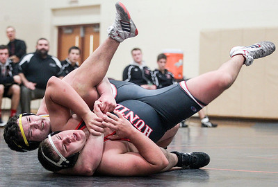Sarah Nader- snader@shawmedia.com Jacobs' Jonny Cieniewicz (left) fights to take down Huntley's Mark Caridai in the 285-pound match Thursday, January 9, 2014. Huntley won the dual, 33-27.