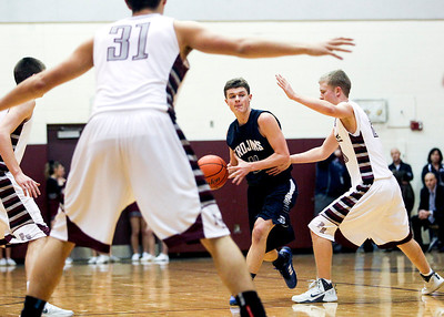 Sarah Nader- snader@shawmedia.com Cary-Grove's Devin McDonough (center) looks for an open teammate during the third quarter of Friday's game against Prairie Ridge January 10, 2013. Cary-Grove defeated Prairie Ridge, 55-29.