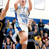 Rosary's Taylor Drozdowski (23) puts a shot up during their game against Aurora Central Catholic Thursday night.