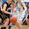 Natalie Droeske (left) of Aurora Central Catholic and Taylor Drozdowski of Rosary (right) go after a loose ball during their game at Rosary Thursday night.