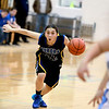Aurora Central Catholic's Gabi Alfaro drives toward the basket during their game at Rosary Thursday night.