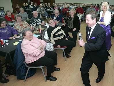 H. Rick Bamman - hbamman@shawmedia.com Duo Ron Camron and Sandie Triplet of Schaumburg sing and dance during a New Year's Eve Gala program at the Senior Services Associates, Inc. of McHenry County. The pair peformed a tribute to Bobby Darin and Sandra Dee Friday in McHenry.