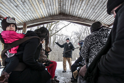 Sarah Nader- snader@shawmedia.com MCCD Education Program Coordinator Andy Talley acts out a fable before letting the group head out to look for winter plant life and signs of animal activity during a winter scavenger hunt hosted by the McHenry County Conservation District at the The Hollows Conservation Area in Cary Sunday, January 12, 2014.