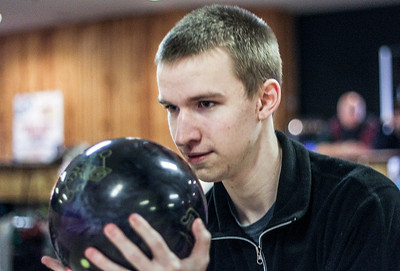 Sarah Nader- snader@shawmedia.com Huntley's Beau Rehner throws a strike at Bowl-Hi Lanes in Huntley during bowling practice Monday, January 13, 2014.