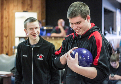 Sarah Nader- snader@shawmedia.com Huntley's Beau Rehner  (left) and Grant Gardner bowl at Bowl-Hi Lanes in Huntley during bowling practice Monday, January 13, 2014.