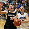 Jeff Krage – For Shaw Media<br /> Burlington Central's Kayla Ross drives toward the basket around Kaneland's Amber Winquist-Bailey during Saturday's game.<br /> Burlington 1/11/14