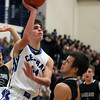 Jeff Krage – For Shaw Media<br /> Burlington Central's Brett Rau goes for a shot during Saturday's game against visiting Kaneland.<br /> Burlington 1/11/14