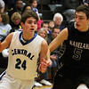 Jeff Krage – For Shaw Media<br /> Burlington Central's Brett Rau drives around Kaneland's John Pruett during Saturday's game.<br /> Burlington 1/11/14