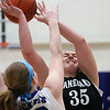 Jeff Krage – For Shaw Media<br /> Kaneland's Brittany Kemp is fouled by Burlington Central's Rebecca Gerke while taking a shot during Saturday's game.<br /> Burlington 1/11/14