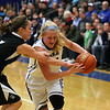 Jeff Krage – For Shaw Media<br /> Burlington Central's Samantha Pryor is guarded by Kaneland's Camri Conley during Saturday's game.<br /> Burlington 1/11/14