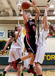 Sarah Nader- snader@shawmedia.com Huntley's Sam Andrews (center) shoots during the fourth quarter of Tuesday's game against Crystal Lake South January 14, 2014. Huntley defeated Crystal Lake South, 54-51.