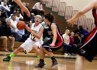 Sarah Nader- snader@shawmedia.com Crystal Lake South's Gaby De Jesus (left) is guarded by Huntley's Kayla Barreto while she bring the ball down court during the second quarter of Tuesday's game in Crystal Lake January 14, 2014. Huntley defeated Crystal Lake South, 54-51.