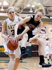 Sarah Nader- snader@shawmedia.com Crystal Lake South's Sara Mickow (left) and Huntley's Morgan Clausen jump for the rebound during the third quarter of Tuesday's game in Crystal Lake January 14, 2014. Huntley defeated Crystal Lake South, 54-51.
