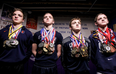 Sarah Nader- snader@shawmedia.com Wrestlers Michael Cullen (left), 20, and his brothers, John, 15, Michael, 17, and Sean, 15, pose for a portrait inside their wrestling training room at their Oakwood Hills home Wednesday, January 15, 2014. Michael, John and Sean all currently wrestling at Cary-Grove. The four boys grew up training together before starting club wrestling as young boys.