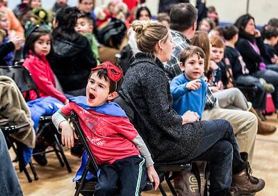 "Sarah Nader- snader@shawmedia.com Dressed as Spiderman, AJ Mitchell, 5, of Crystal Lake waits for the start of Super Hero Literacy Night hosted by North Elementary in Crystal Lake Wednesday, January 15, 2014. Amy Logan discussed her book ""A Girl With A Cape"" while Jarrett Payton spoke about the importance of kindness and philanthropy."
