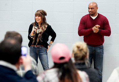 "Sarah Nader- snader@shawmedia.com Local author, Amy Logan (left) and motivational speaker, Jarrett Payton spoke to a crowd during Super Hero Literacy Night hosted by North Elementary in Crystal Lake Wednesday, January 15, 2014. Logan discussed her book ""A Girl With A Cape"" while Payton discussed the importance of kindness and philanthropy."