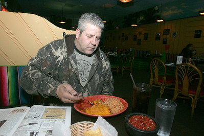 H. Rick Bamman - hbamman@shawmedia.com Long-time waitress Jennifer Falbo in now the owner of Pablo's Mexican Restaurant. Customer Adam Brandstetter has been frequiting  Pablo's for 8 years. Server Sam Quinney. Bob and Debbie Tastsides of CL. Head chef Noe Garcia 18 years at Pablo's. Line cooks Carlos Cordoba (red) and Ismael Geron.  Yellow plate shrimp Enchilada mazalan red- Enchiladas Suizas