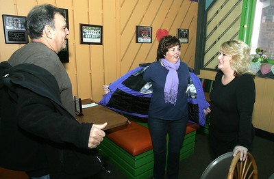 H. Rick Bamman - hbamman@shawmedia.com New owner of Pablo's Mexican Restaurant Jennifer Falbo greets long-time customers and freinds Bob and Debbie Tastsides of Crystal Lake. Falbo a long-time waitress bought the eatery from the former owner Paul Morin.