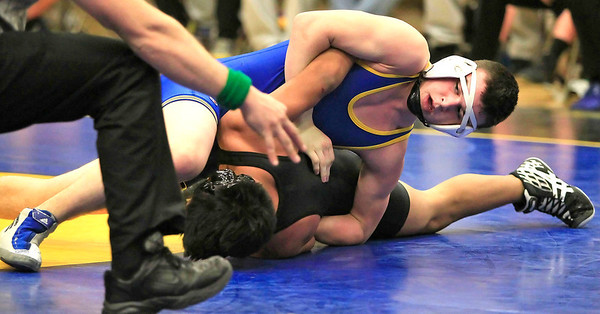 Candace H. Johnson Johnsburg's Andrew Calhoun watches the referee as he pins Crystal Lake Central's Eduardo Diaz, both 15, in the 138 lb. weight class during their wrestling match at Johnsburg High School. Johnsburg's Andrew Calhoun won by a pin.