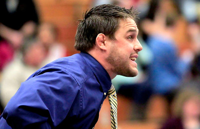 Candace H. Johnson Johnsburg's Jon Murphy, head coach, talks to one of his wrestlers during their match at his team's wrestling meet against Crystal Lake Central at Johnsburg High School.