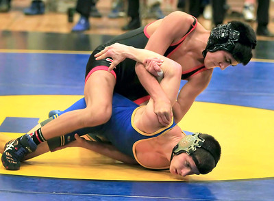 Candace H. Johnson Crystal Lake Central's Lenny Petersen, 15, works on a pinning Johnsburg's Nash Miller,16, in the 126 lb. weight class during their wrestling match at Johnsburg High School. Crystal Lake Central's Lenny Petersen won by a pin.