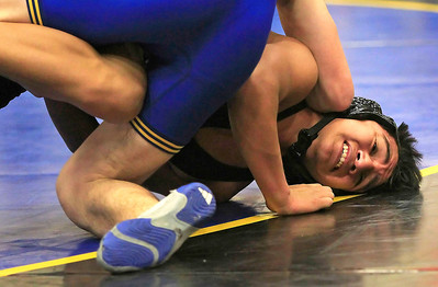 Candace H. Johnson Johnsburg's Andrew Calhoun takes the controlling position against Crystal Lake Central's Eduardo Diaz, both 15, in the 138 lb. weight class during their wrestling match at Johnsburg High School. Johnsburg's Andrew Calhoun won by a pin.