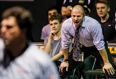 Kyle Grillot - kgrillot@shawmedia.com   Crystal Lake South coach Ross Ryan shouts towards Buddy Caridai during the final match of the dual Thursday in Crystal Lake. Crystal Lake South won the dual, 39-34.