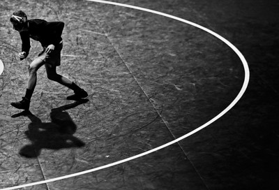 Kyle Grillot - kgrillot@shawmedia.com   Huntley senior Nick Meyer warms up before the start of the Dual against Crystal Lake South Thursday Jan 16, 2014. Huntley lost the dual, 39-34.