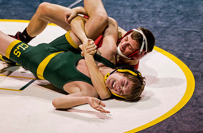 Kyle Grillot - kgrillot@shawmedia.com   Huntley senior Nick Meyer (top) goes for a pin during his match against Crystal Lake's Ryan Bruns Thursday in Crystal Lake. Huntley lost the dual, 39-34.