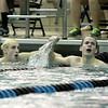 Ross Davis of St. Charles North (right) reacts to winning the varsity heat of the 200-yard individual medley over St. Charles East's John Tarpey (left.)