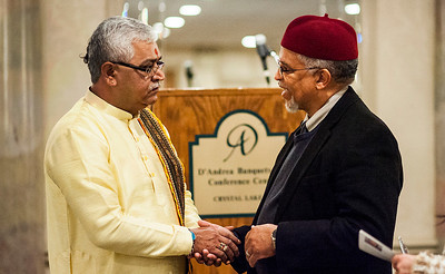"Kyle Grillot - kgrillot@shawmedia.com   Pandit Anil Joshi of Grayslake (left) talks with Imam Plemon T. El-Amin after the conclusion of the Fifth Annual Interfaith Prayer Breakfast celebrating the life and legacy of Dr. Martin Luther King, Jr. Monday in Crystal Lake. The theme for this year's event is ""My Dream for the World."""