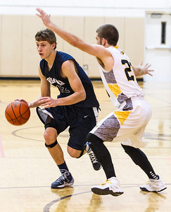Kyle Grillot - kgrillot@shawmedia.com   Cary-Grove senior Jason Gregoire (12) dribbles towards the net guarded by Jacobs senior Ben Murray (23) during the fourth quarter of the basketball game Tuesday in Algonquin. Jacobs beat Cary-Grove, 47-43.