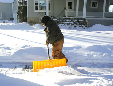 H. Rick Bamman - hbamman@shawmedia.com Elias Andrade shovels a sidewalk in single digit temperatures Tuesday, Jan. 21, 2014. Andrade was working at the corner of Church St. and Second Street in Huntley. Low wind chill values are expected to persist through the rest of the week.