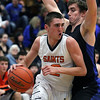 Jeff Krage – For Shaw Media<br /> St. Charles East's Dom Adduci drives baseline around St. Charles North's Erik Miller during Saturday's game.<br /> St. Charles 1/18/14