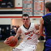 Jeff Krage – For Shaw Media<br /> St. Charles East's Dom Adduci drives toward the basket during Saturday's game against visiting St. Charles North.<br /> St. Charles 1/18/14