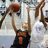 Jeff Krage – For Shaw Media<br /> Batavia's Bethany Orman goes up for a shot Monday against Joliet Catholic's Christina Ekhou, left, and Nicole Ekhou during the 24th annual McDonald's Shootout at Willowbrook High School.<br /> Villa Park 1/20/14